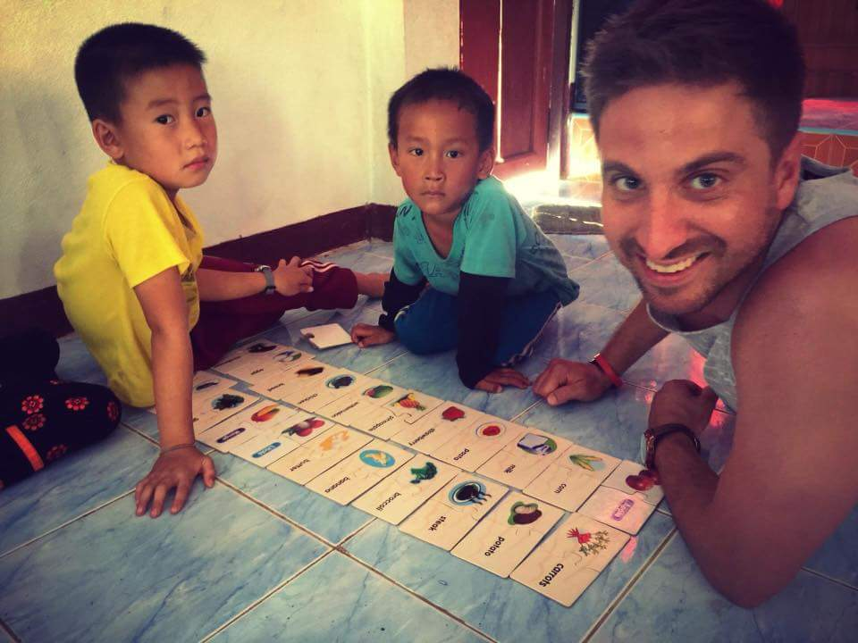 Having fun with the kids after donating presents at a Thai orphanage.
